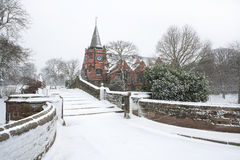 English village bridge in winter snow. Royalty Free Stock Photos