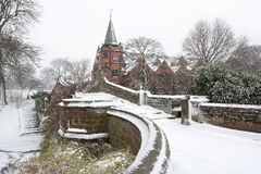 English village bridge in winter snow. Stock Image