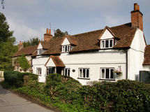 English Village Cottage. Pretty Cottage alongside a quiet Village street in England Stock Photo