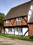 English Village Cottage. Historic and quaint Timber Framed Cottagei n a Rural English Village Royalty Free Stock Image