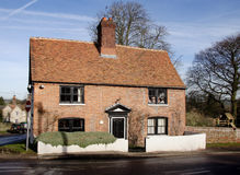 English Village Cottage. Winter sunshine on a Red Bricked English Village Cottage Royalty Free Stock Photography