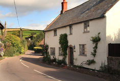 English Village Cottage next to a quiet Lane Stock Image