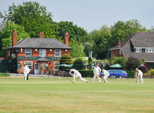 An English Village Cricket Match. English Village Crcket Match with Tradional Pub in the background Royalty Free Stock Photo