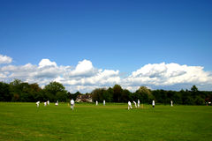 English village cricket match. A game of village cricket on an English summer day Royalty Free Stock Photo