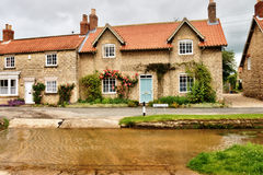 English village with ford. Royalty Free Stock Images