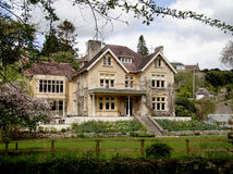 English Village House. Grand Natural Stone  Mullion windowed English Manor House Royalty Free Stock Photos