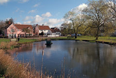 English village pond. On village green with small shops and houses reflected in water Stock Photography