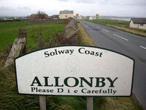 English village sign. Road sign entering the village of Allonby, England Stock Image