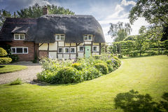 English Village Thatched Cottage and garden Royalty Free Stock Images