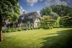 English Village Thatched Cottage and garden Stock Images