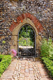 An English Walled Garden. With arched entrance through the Wall Royalty Free Stock Photo