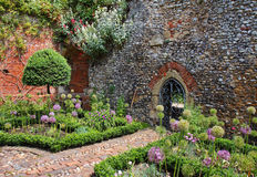 An English Walled Garden. With arched entrance through the Wall Royalty Free Stock Photography