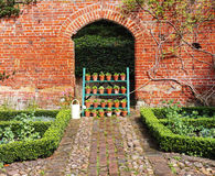 An English Walled Garden with flowerpot display Royalty Free Stock Photography
