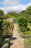 An English Walled Garden with Path Royalty Free Stock Photo