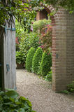English walled garden. Wooden door in English walled garden royalty free stock image