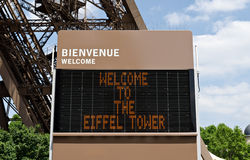 English welcome sign of the Eiffel Tower in Paris. Stock Images