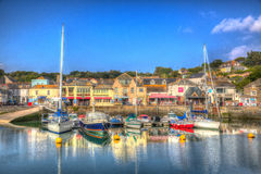 English west country Padstow harbour Cornwall England UK with boats in brilliant colourful HDR. Padstow harbour North Cornwall England UK with boats on calm day Stock Photos