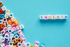 English word with letter beads on blue background royalty free stock photo