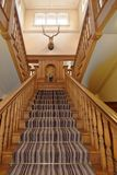 Engllish country house, wooden stairs and carpet strip. deer head royalty free stock photography