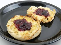 Englsih Muffin with Jam. English Muffin with jam and butter, Toasted and ready to eat Royalty Free Stock Photos