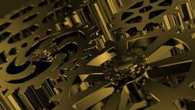 Engranajes de oro giratorios aislados El movimiento del metal adapta en un dispositivo mecánico metrajes