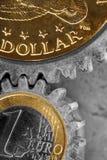 Engranajes del dinero Imágenes de archivo libres de regalías
