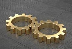 Engranajes del oro, conectados, en piso tejado metal reflexivo Fotografía de archivo libre de regalías