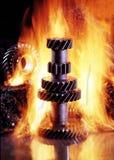 Engranajes en fuego imagen de archivo libre de regalías