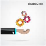 Engranajes geométricos con la mano del hombre de negocios en el fondo, industrial Imagenes de archivo