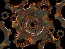 Engranajes oxidados en el fuego Imagen de archivo libre de regalías