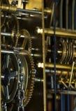 Engranajes y encadenamiento del reloj Imagen de archivo libre de regalías