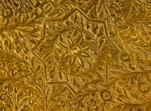 Engraved. Engraven patterns on the brass shield Stock Photos