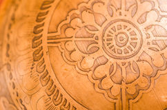 Engraved Brass Bowl Close-up. A close-up shot of the base of an engraved brass singing bowl stock images