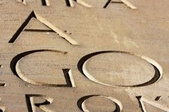 Carved inscription. Engraved, carved in stone GO inscription - sandstone carved letters Royalty Free Stock Photography