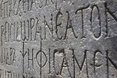 Engraved greek text. Engraved stone with ancient greek text (Gortyna, Crete, Greece stock photo