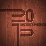 Engraved 2015 Happy New Year typographic design  on wood texture background. Stock Image