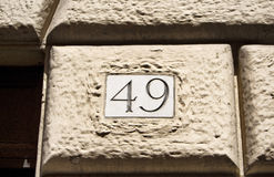 Engraved old building number stock photography