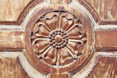 Engraved on the old Wooden door Royalty Free Stock Image