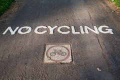Engraved painted traffic sign no cycling on park Royalty Free Stock Image