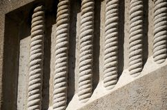 Engraved pillars on the side of a building Royalty Free Stock Photos