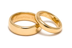 Engraved rings. Two engraved golden rings, for wedding or engagement Royalty Free Stock Photo