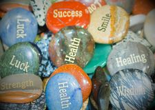 Engraved rocks that show words of wisdom and encouragement. Engraved rocks that show words of wisdom and encouragement in a shiny pile stock images