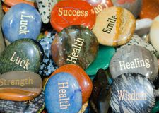 Engraved rocks that show words of wisdom and encouragement. Engraved rocks that show words of wisdom and encouragement in a shiny pile stock image