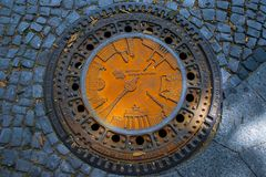 Engraved Sewer metal drain cover stock photography
