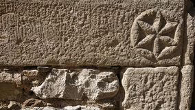 Engraved Stone. An interesting design engraved into a stone wall 300 years ago stock photos