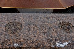 1867 engraved. On stone surrounding the Centennial Flame in front of Parliament House in Ottawa, Ontario stock photo