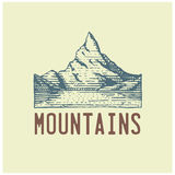 Engraved vintage logo with mountains in hand drawn, sketch style, old looking retro badge for national parks and camping Royalty Free Stock Image