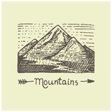 Engraved vintage logo with mountains in hand drawn, sketch style, old looking retro badge for national parks and camping Stock Images