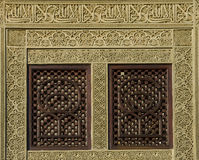 Engraved window. Islamic and Arabic Art on engraved window with calligraphy on top and the rest with decorative patterns Stock Image
