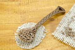 Engraved wooden spoon filled with linseeds Stock Image